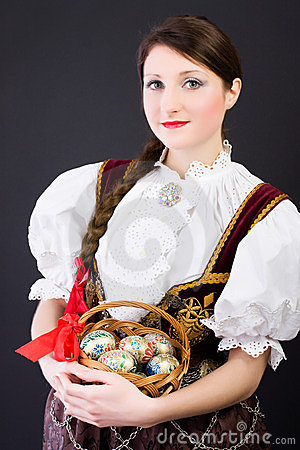 Woman in traditional Polish clothes basket of eggs
