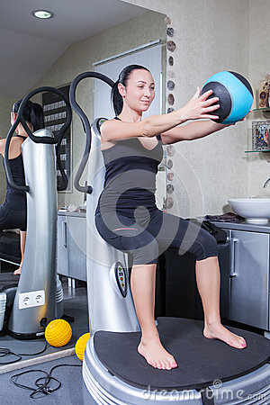 Woman on trainer machine in sport gym