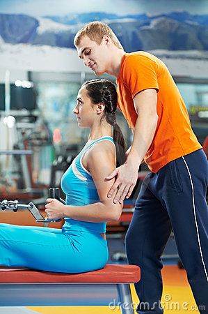 Woman with trainer at training simulator