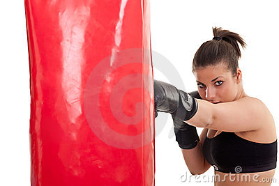 Woman training in boxing on punching bag