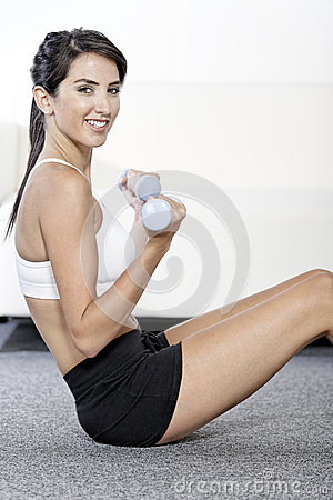 Woman training with weights