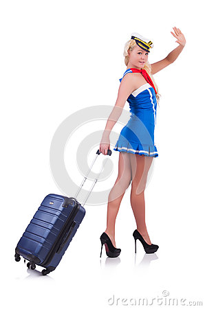 Woman travel attendant with suitcase