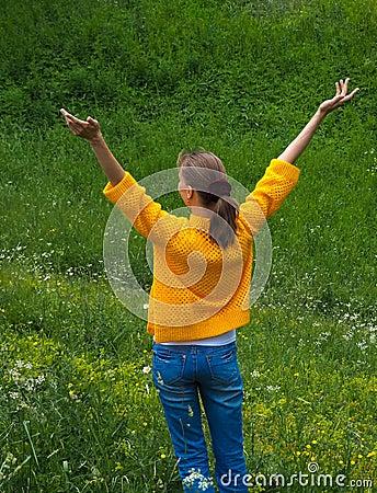 Free Woman Traveler On A Walk Among The Green Grass. Stock Image - 119350931