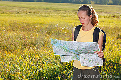 Woman traveler read the map