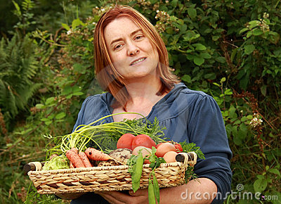 Woman with tray of vegetables