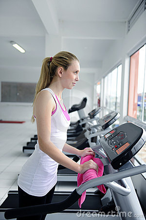 Woman on treadmill at the gym