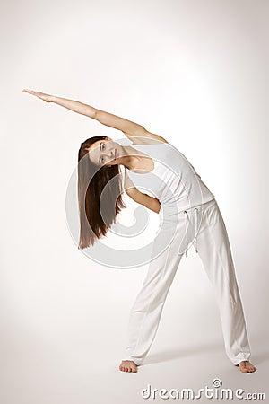 Woman in triangle Yoga posture (Trikonasana)