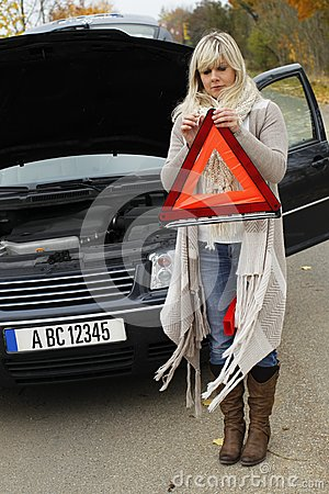 Woman tries to open an emergency sign