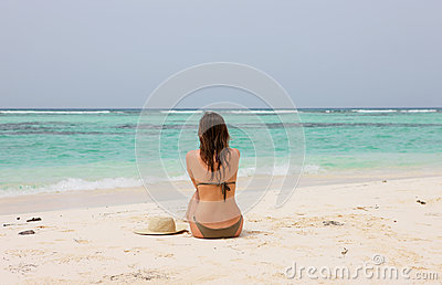 Woman in a tropical beach