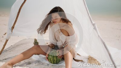 Woman on the Tropical Beach Eating Watermelon stock video
