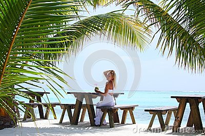 Woman in a tropical cafe