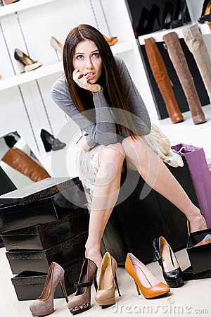 Woman trying on footwear in the shop