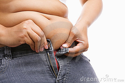Woman trying hand to zipper her jeans