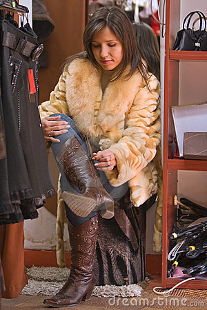 Woman trying on new boots