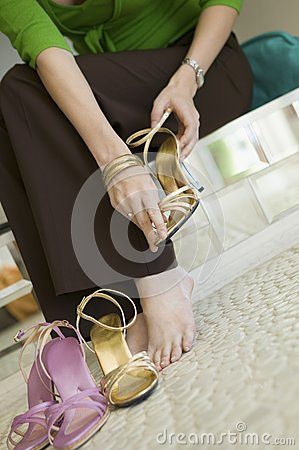 Free Woman Trying On Shoes In Clothing Store Low Section Ground View Royalty Free Stock Photo - 30840365