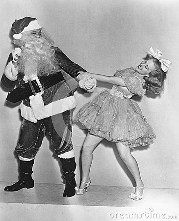 Free Woman Trying To Dance With Santa Claus Royalty Free Stock Image - 51999306