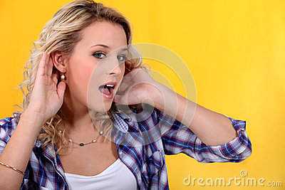 Woman trying to hear better
