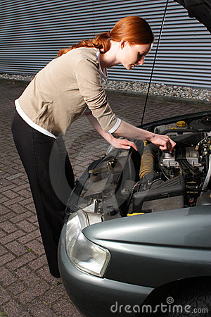 Woman Trying to Repair a Car