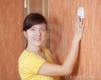 Woman turning off the light switch