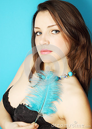 Woman with turquoise feather