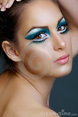 Woman with turquoise make-up.