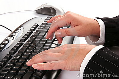 Woman typing on the keyboard