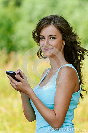 Woman is typing with stylus on