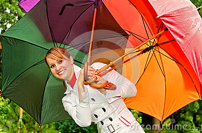 Woman with umbrellas