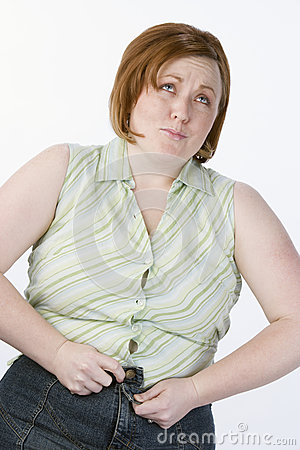 Woman Unable To Button A Jeans