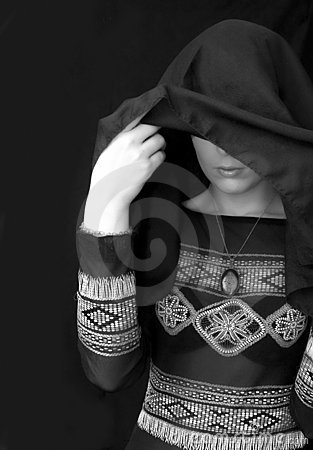 Woman uncovering face