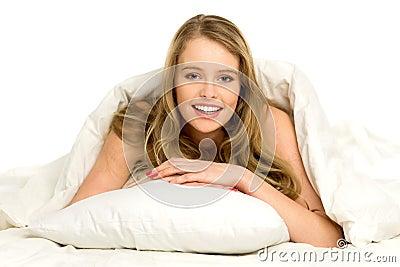Woman under a duvet