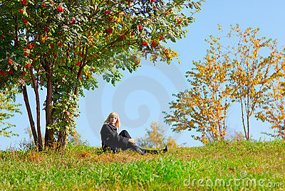 Woman under mountain ash tree