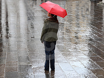 Woman under red umbrella
