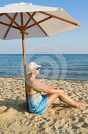 Woman under a solar umbrella