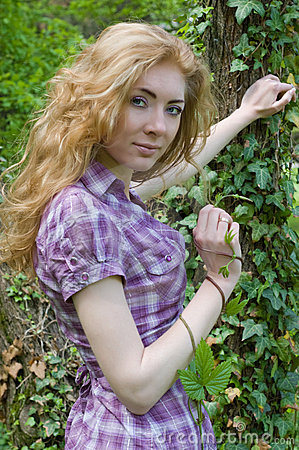 Woman under tree with climber plant