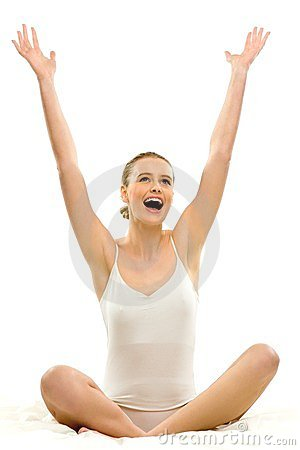Woman in underwear with arms raised