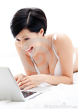 Woman in underwear is working on the silver laptop