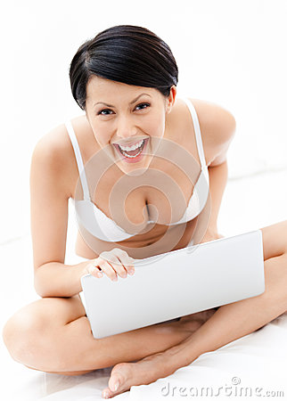 Woman in underwear is working on the thin computer