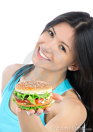 Woman with unhealthy burger in hand