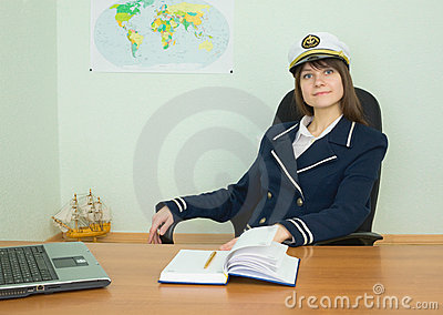 Woman in uniform of the seaman at tourist office