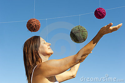 Woman and a universe of wool balls