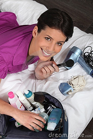 Woman unpacking beauty essentials