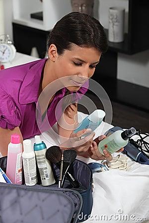 Woman unpacking beautycase