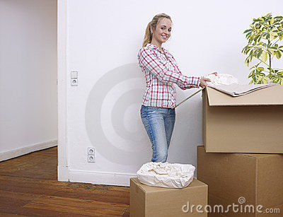 Woman unpacking boxes