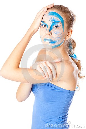 A woman with unusual make-up in studio