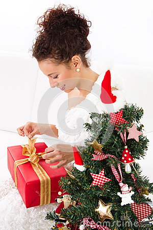 Woman unwraps christmas gift