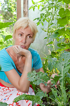 Woman is upset - caterpillars eat leaves of plants