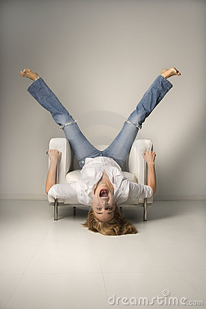 Free Woman Upside Down In Chair. Stock Photography - 2424652