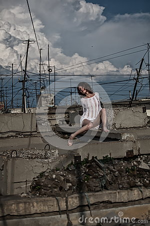 Woman among urban decay