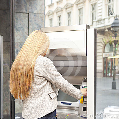 Woman use Bank ATM machine